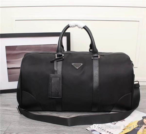 Küresel ücretsiz kargo klasik lüks paket Tuval deri inek derisi erkek seyahat çantası en kaliteli çanta 8001 boyutu 50 cm 28 cm 27 cm