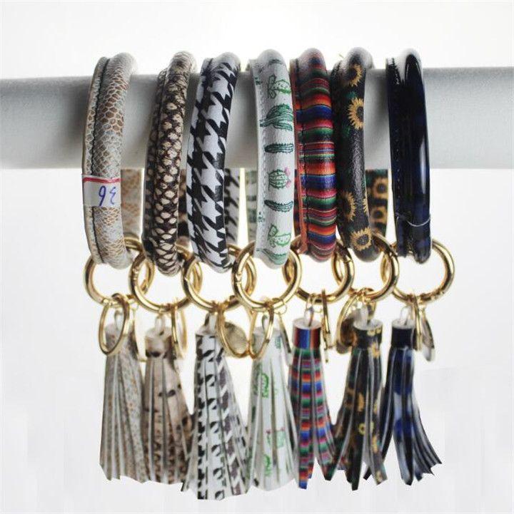 Llavero de la pulsera del brazalete pulseras pendientes del estilo bohemio de cuero de la PU llavero redondo de la borla de la gota de aceite para las mujeres muñeca de la muchacha de la correa T578