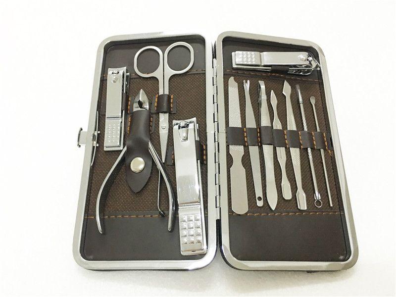 12pcs Manicure Set Pedicure Scissor Tweezer Kett'orecchio Pick Pick Utility Nail Clipper Kit, Set di strumenti per la cura del chiodo in acciaio inossidabile