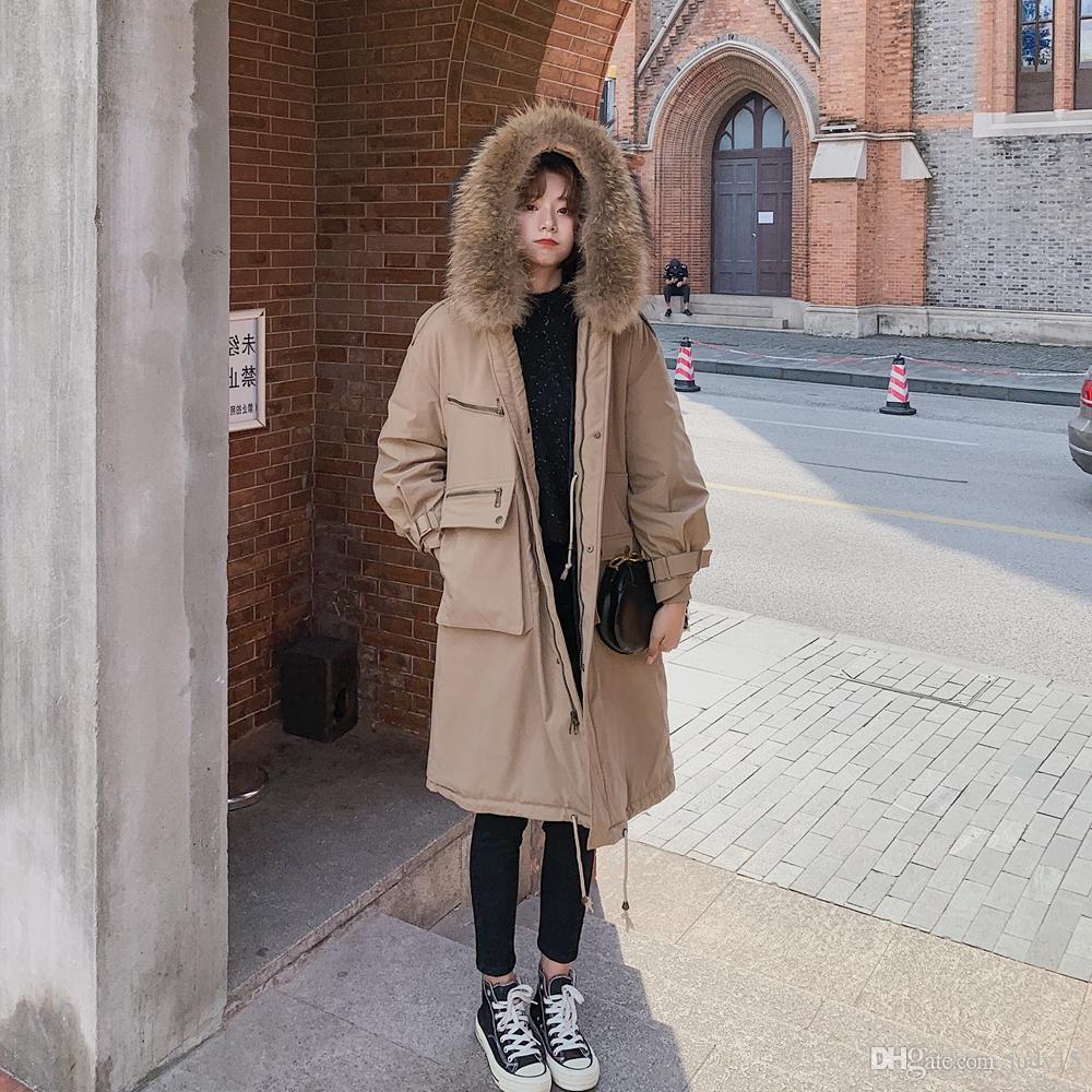 Moda al por mayor de las mujeres por la chaqueta larga con capucha de piel real del mapache del ajuste de la chaqueta