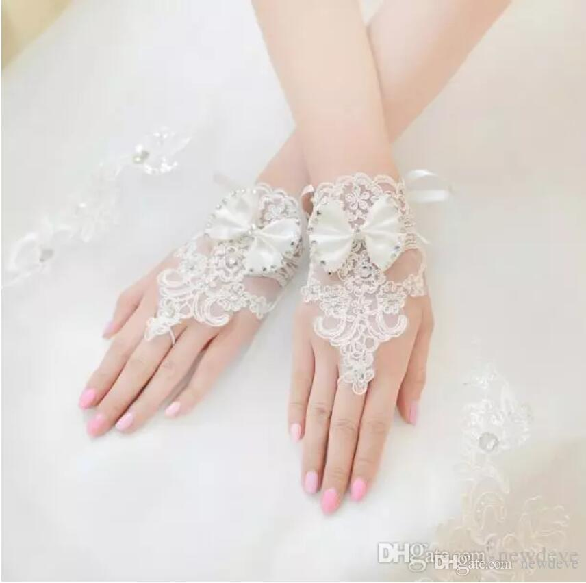 Hohe Qualität Weiße Fingerlose Brauthandschuhe Für Brautkleider Kurze Handgelenklänge Elegante Strass Braut Hochzeit Handschuhe Brauthandschuh