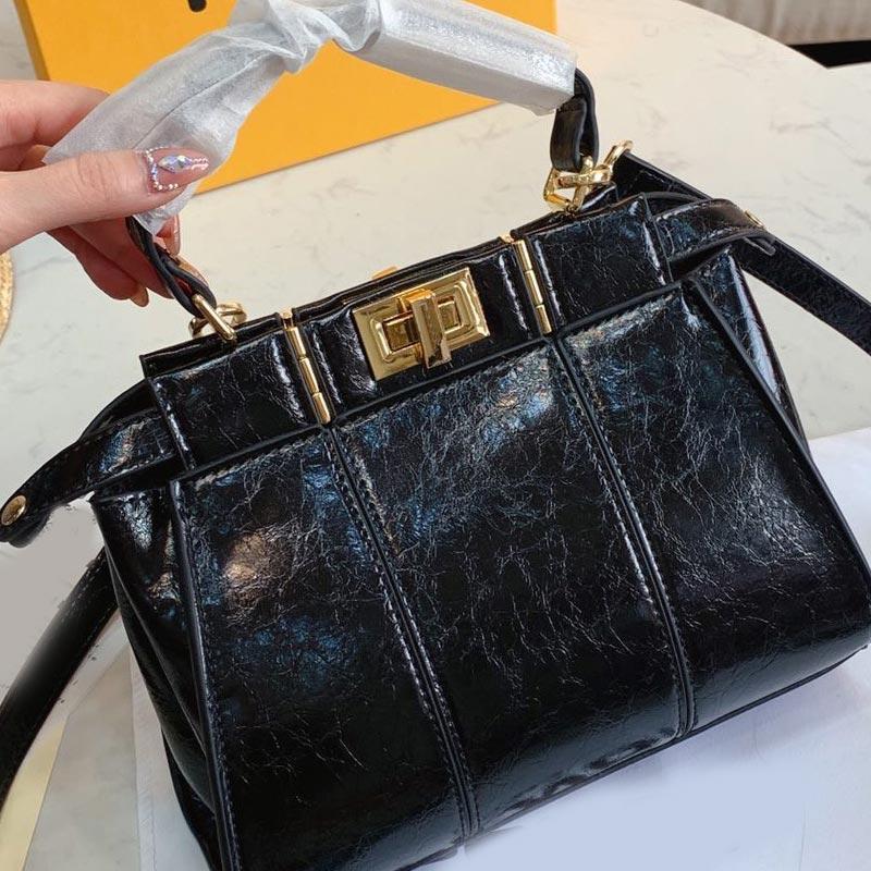التعامل مع حقائب CROSSBODY حقيبة حقيبة تسوق الأزياء عالية الجودة النساء واحدة حقيبة جلد طبيعي عادي زر شحن مجاني