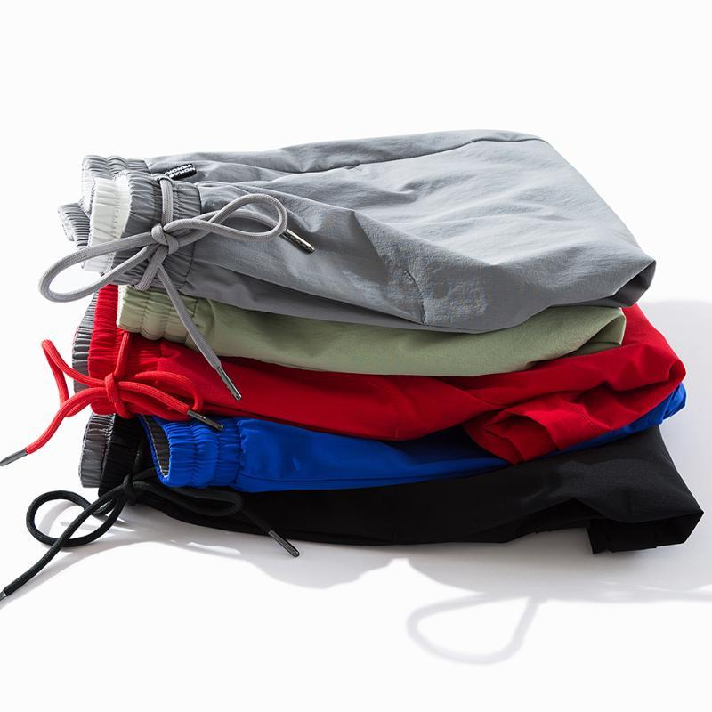 8XL Plus Size uomini 2020 Nuova Shorts elastico casuale solido estate uomini di modo Loose Fit tasche dei pantaloni Short Shorts BigTall Maschio