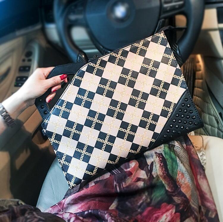 Factory wholesale brand men handbag street trend check wrist bag personality rivet shoulder Messenger bag fashion printed leather envelope b