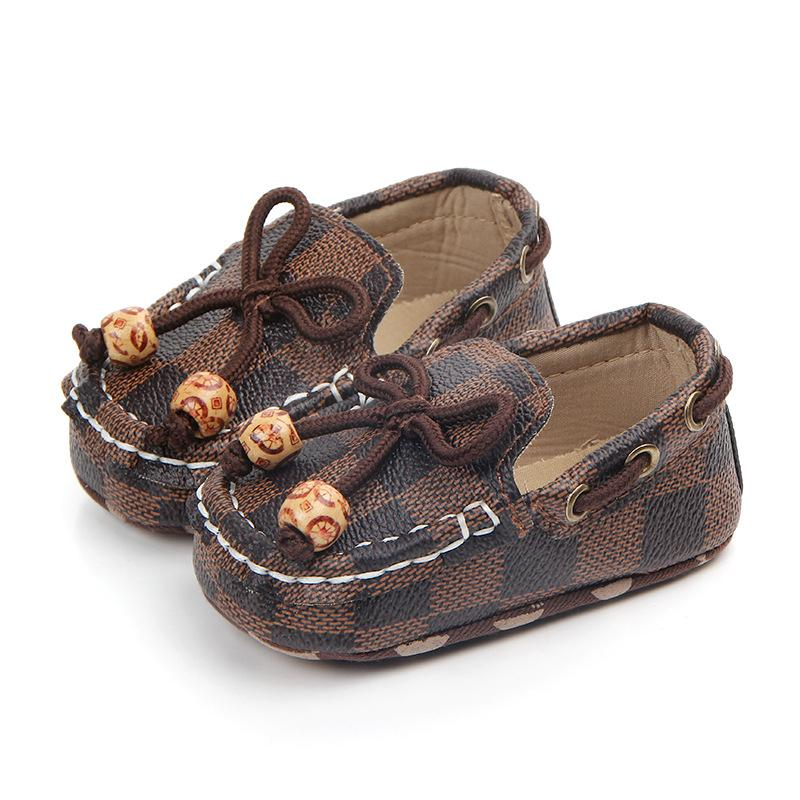 Neugeborenes Baby Leder Krippe Schuhe Peas Schuhe weiche Sohle Sneaker Baby Erste Wanderer