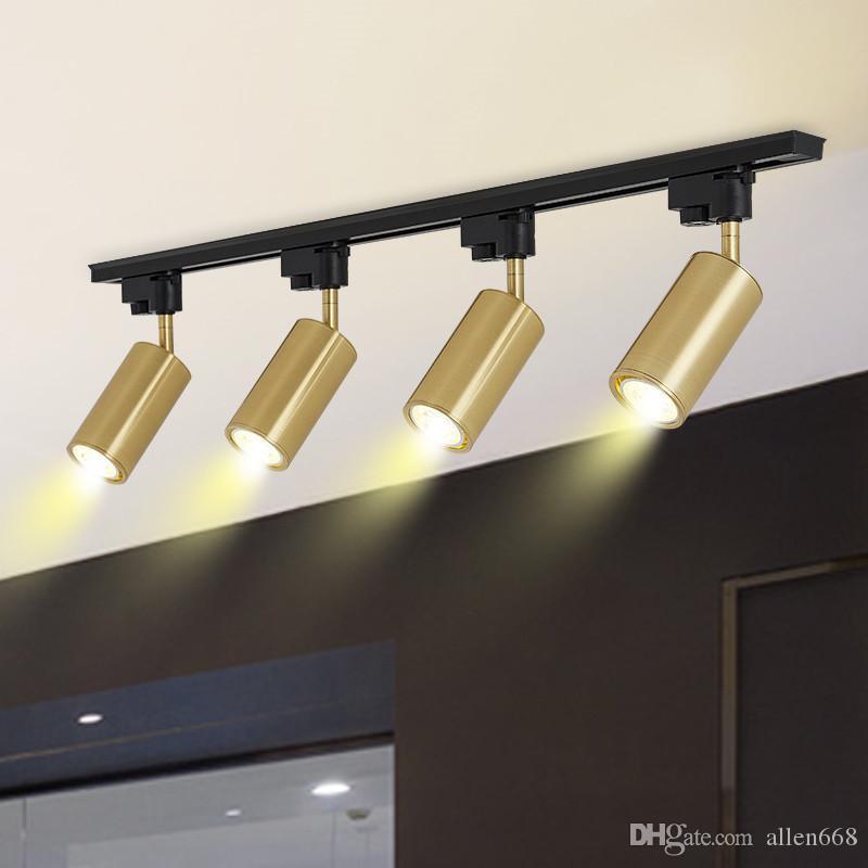 moderna del soffitto del metallo dell'oro rotante Faretti a LED lampada a sospensione a parete montato il riflettore della luce della luce della pista Guardaroba Sfondo
