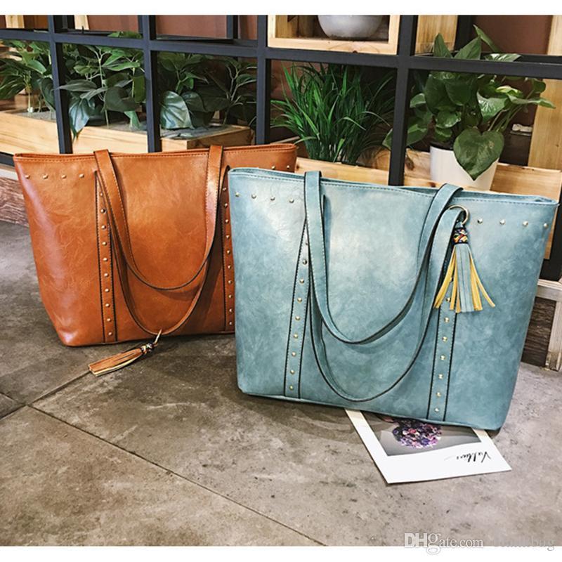 broderie pompon faux chaud femmes de mode en cuir grand sac sac à bandoulière rivet simple Casual Handbags fourre-tout femmes zipper grands sacs supplémentaires
