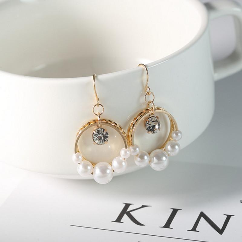 personalidad de la moda pendientes salvajes pendientes simples creativa perla colgante nueva joyería 2019