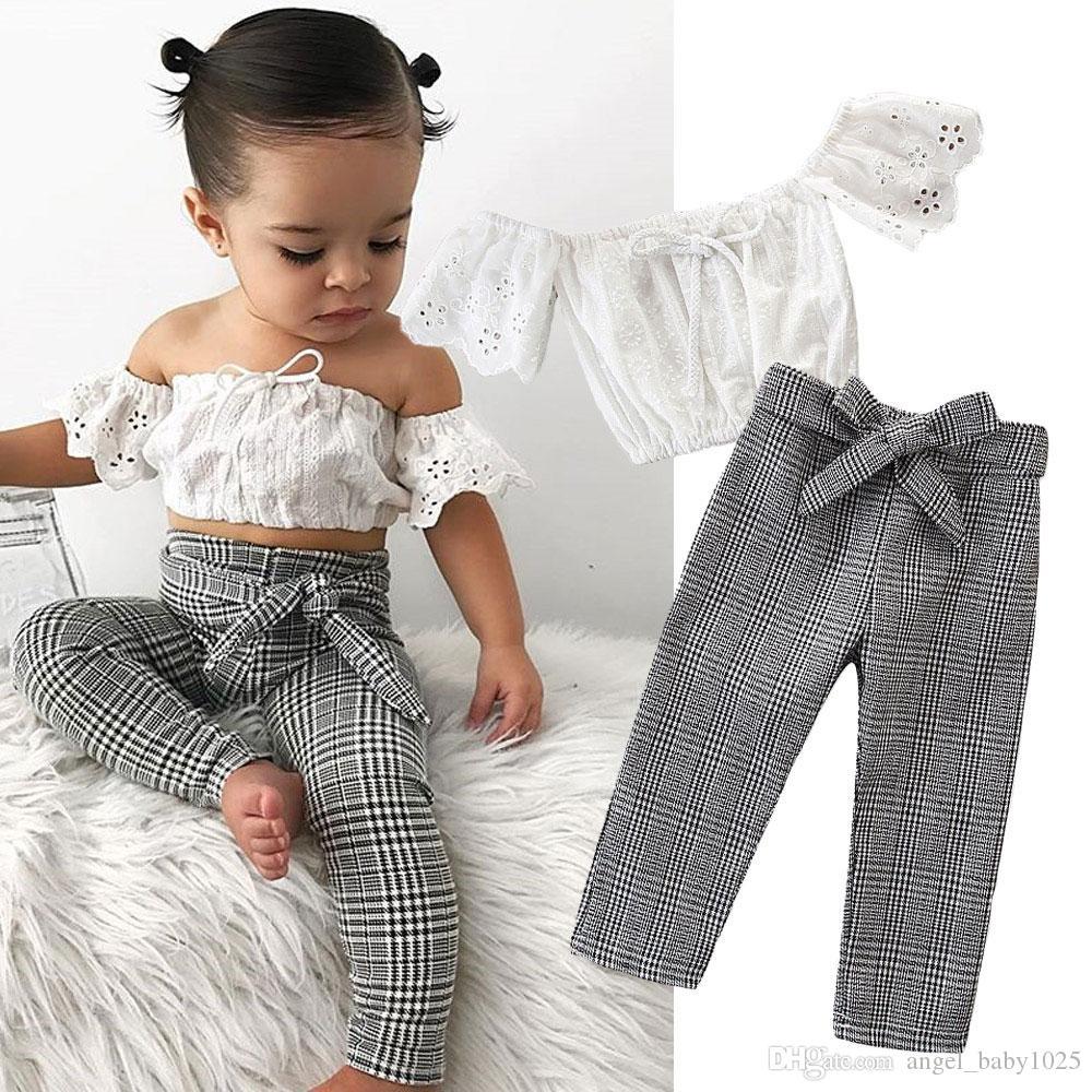 Neue Kinderkleidung Anzug Sommer Mädchen weiß Wort Schulter Hemd + Karohose zweiteilig