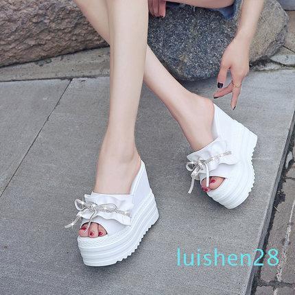 Zapatillas de mujeres 2019 nueva moda del arco del verano pendiente plataforma impermeable salvaje con una palabra sandalia L28