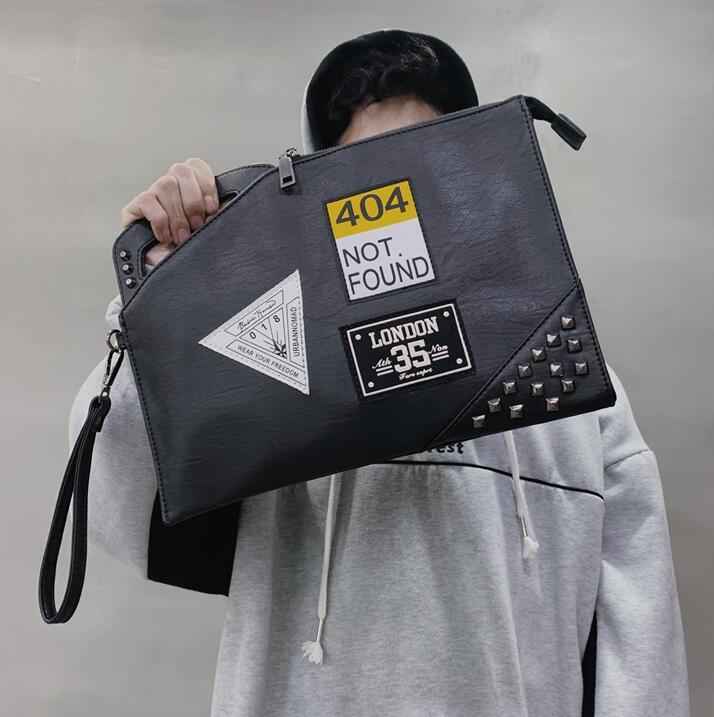 Wholesale brand men handbag personality pattern men and women handbag street trend rivet hand clutch new medal shoulder Messenger bag