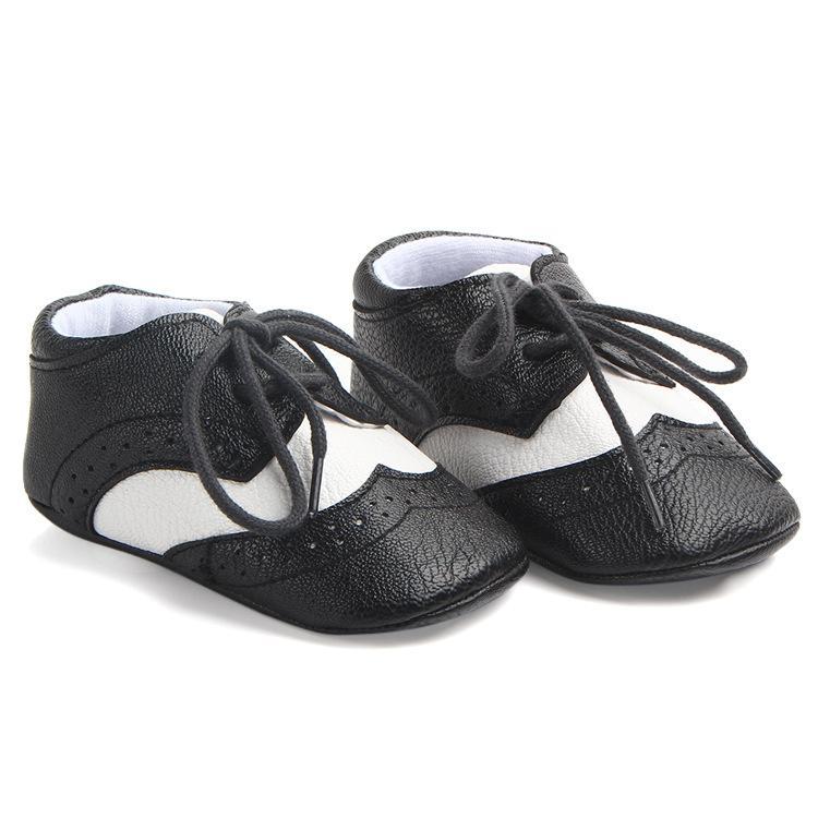Neugeborene Babyschuhe Erste Wanderer Krippe Baby-Mokassin weiche Unterseite PU-Leder Junge Schuhe