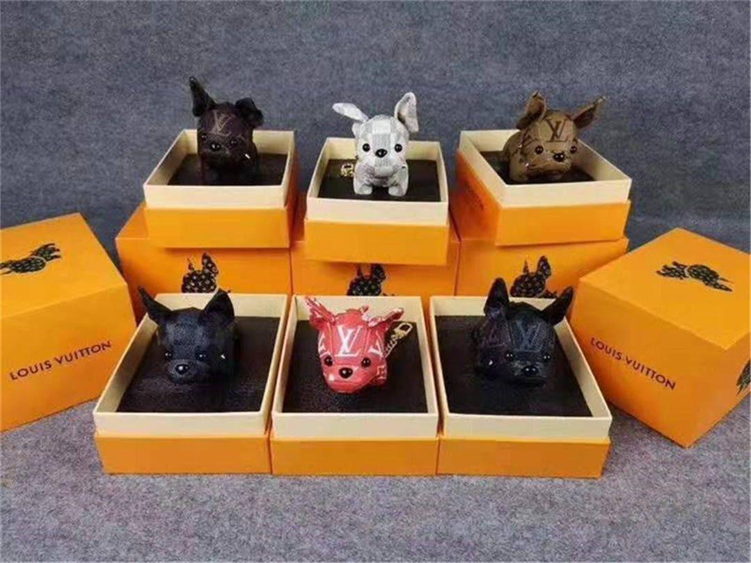 Llaveros de lujo de alta calidad Llavero de diseñador Hebilla Monedero Bolsos colgantes Bolso de diseño de estilo de perro Cadenas de muñeca Hebillas de llave 6 colores con caja Opcional