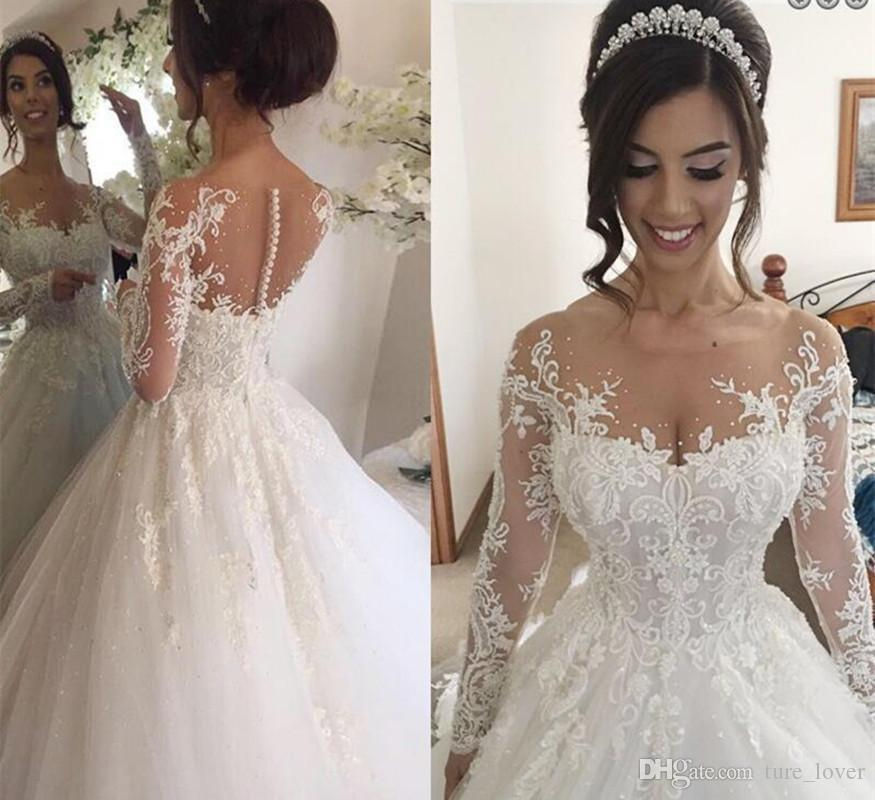 Illusion Jewel Long Sleeves A-Line Wedding Dresses with Beading Appliques Chapel Train Puffy Skirt Arabic Church Bridal Gowns Plus Size