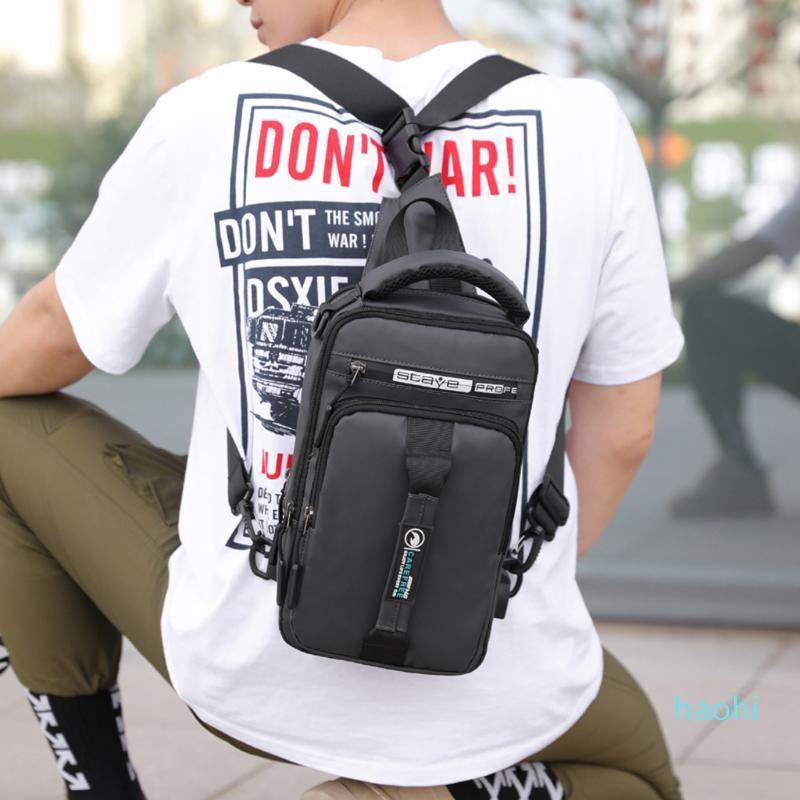 Tasarımcı-Sırt Erkek ve kadın USB Oxford bez su geçirmez büyük kapasiteli çanta sırt çantası Çok yönlü çanta mochila Feminina bolsa 2.7