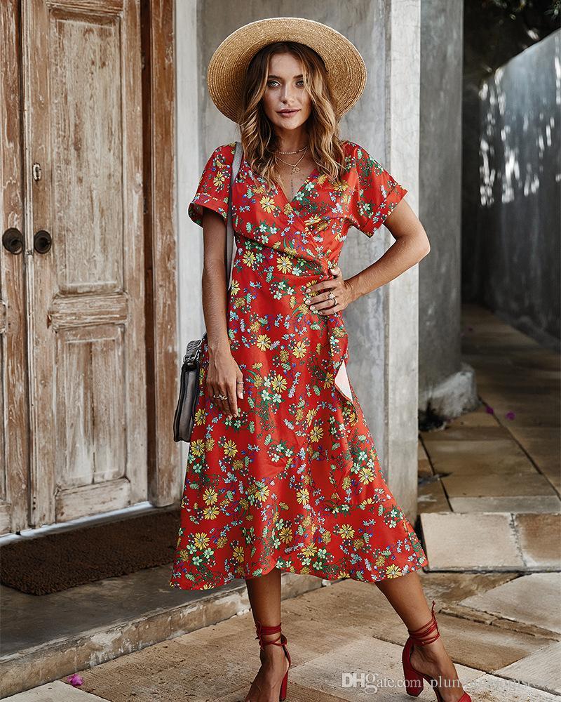 Frauen Sommerkleider 2020 Neue Mode Schärpen Unregelmäßige Blumen Gedruckt Böhmischer Strandkleid Sexy V-Ausschnitt Kurzarm Casual Boho Lang Dr. Ilal
