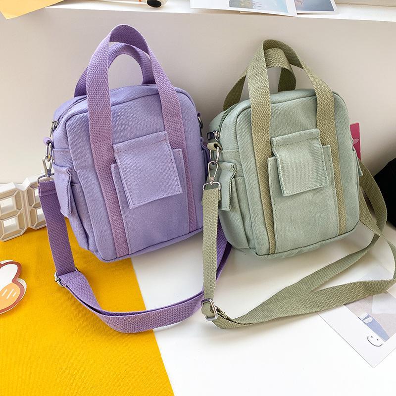 Verano sólida tendencia Estudiante de color Multi-bolsillo portátil pequeña lona del bolso de hombro del color del caramelo bolso de la manera bolsas de mano 2020 NUEVO