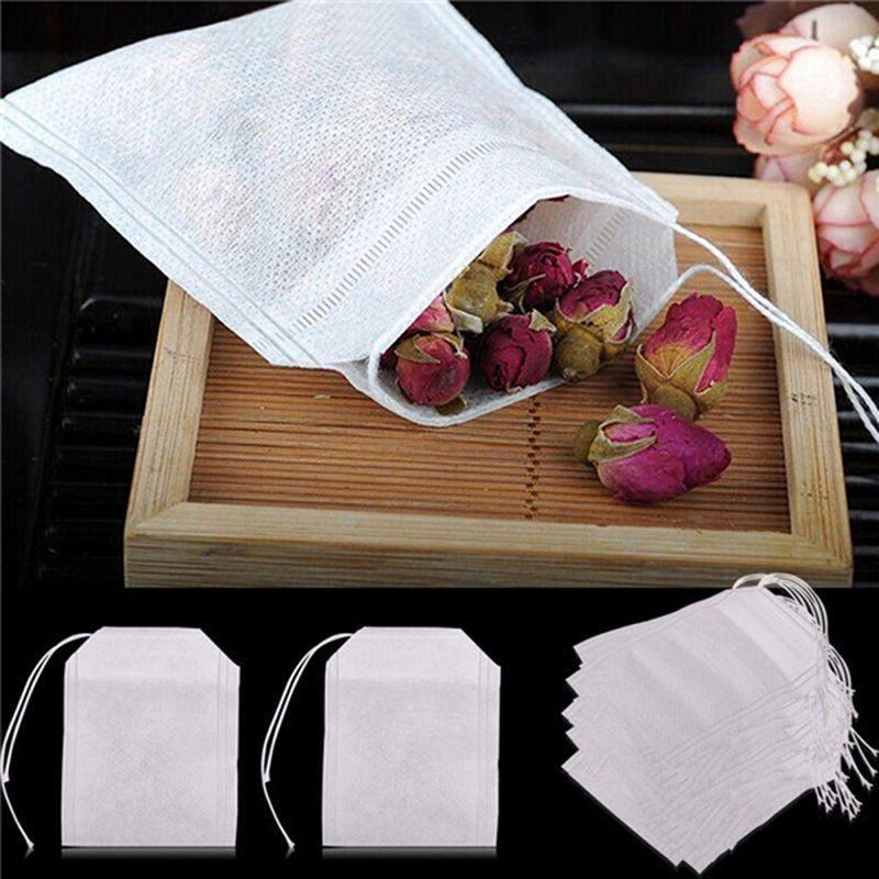 100Pcs / Lot Teabags 5,5 x 7CM bustine di tè profumate vuote con stringhe Heal Seal filtro carta per bustine di tè allentato di erbe