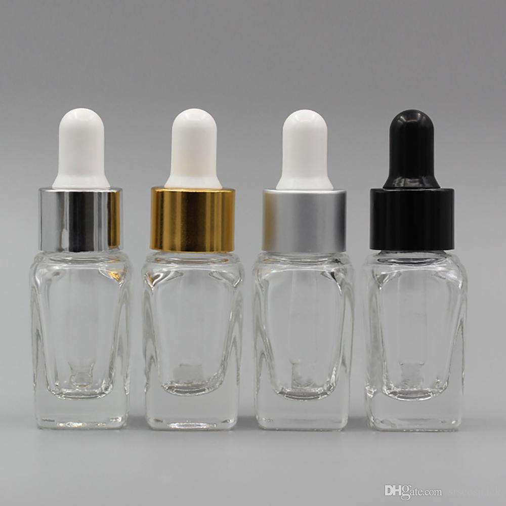 مزود بزجاجة زيتية زجاجية ذات سعة 10 مل ، زجاجة زجاجية صافية مربعة ضرورية مع قطرة ذهبية أو فضية ، زجاجة نفط فارغة