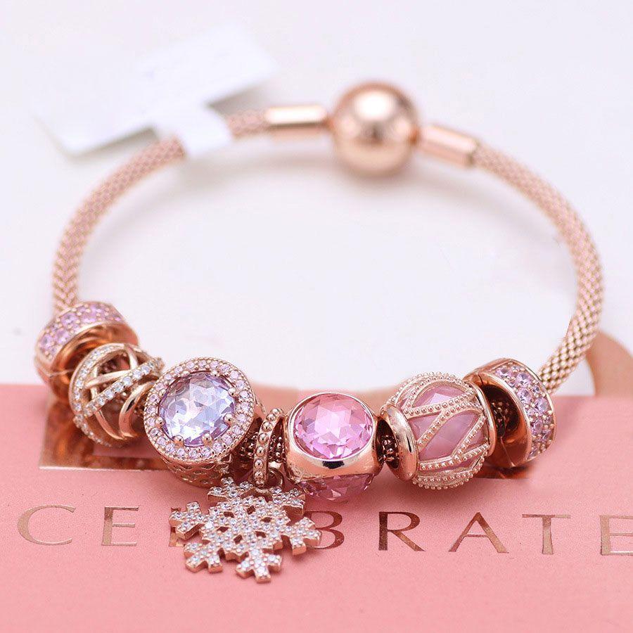 pandora silver and rose gold charm bracelet