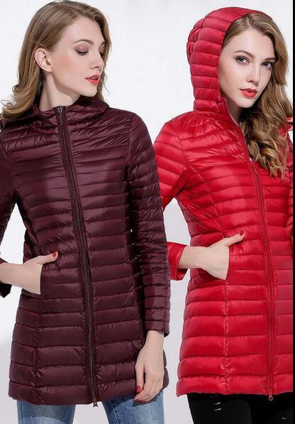 2020 mujeres / marca KIS poco voluminoso clásico patrón largo del norte de Down chaquetas de la capa al aire libre Chaquetas ligeras cara del agua de las mujeres abajo cubren