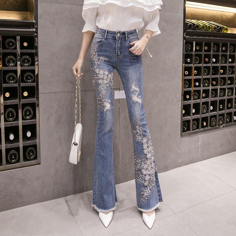 Flare-Jeans Frauen-Europa-Art 2020 Stickerei Blume Sicke dünne Denim-Hosen Weiblich Jean Hosen A3231
