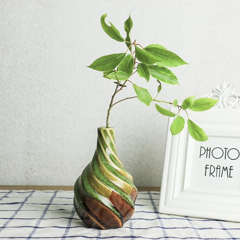 دوامة تويست هدية الإبداعية الحديثة الخزف زهرية السيراميك اناء للزهور المزهريات غرفة الدراسة الرئيسية مناسبات الزفاف الشمال حلية