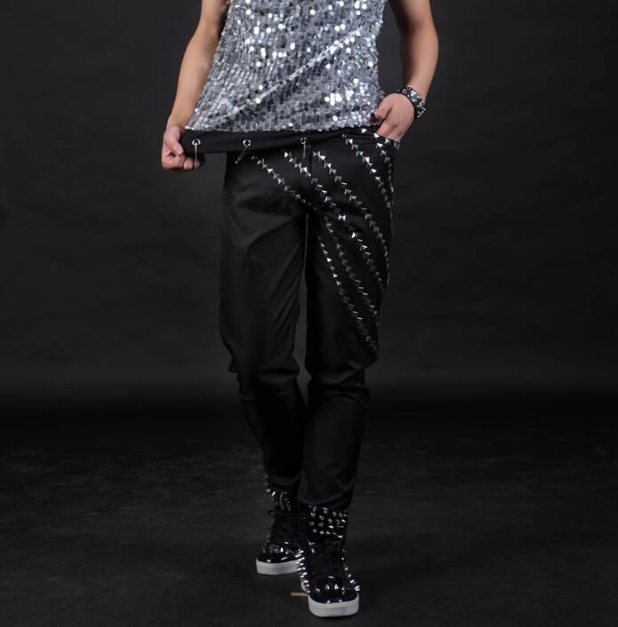 Sahne kişilik erkek pantolon eğik perçinler pantolon erkekler ayak pantolon şarkıcı dans kaya moda pantalon homme sokak siyah harem