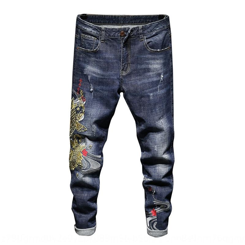 Autumn embroidered men's slim feet personalized fashion jeans and jeans brand hole Chinese fashion autumn pants