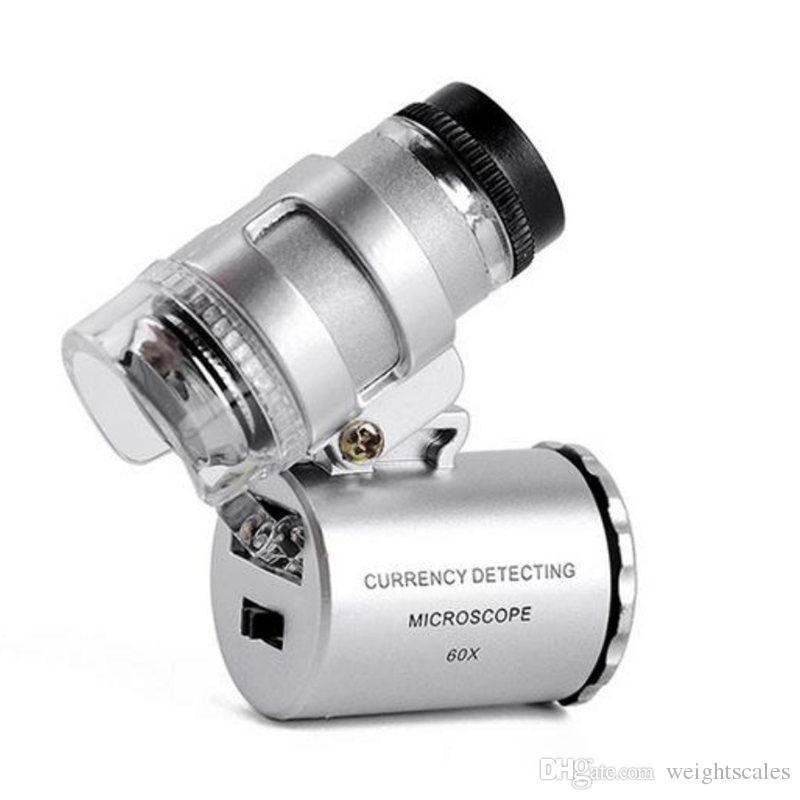 360PCS / CTN 60x Palmare mini microscopio tascabile Microscopio Leggera Legno Lamente LED LED Luce facile da trasportare con una lente d'ingrandimento A660