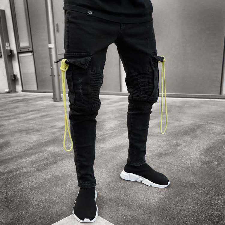 Europa und Amerika heiße verkaufende Männer Schwarze Jeans-Bleistift-Kasten Elastizität mit Löchern Zipper dünne Hosen-Mode