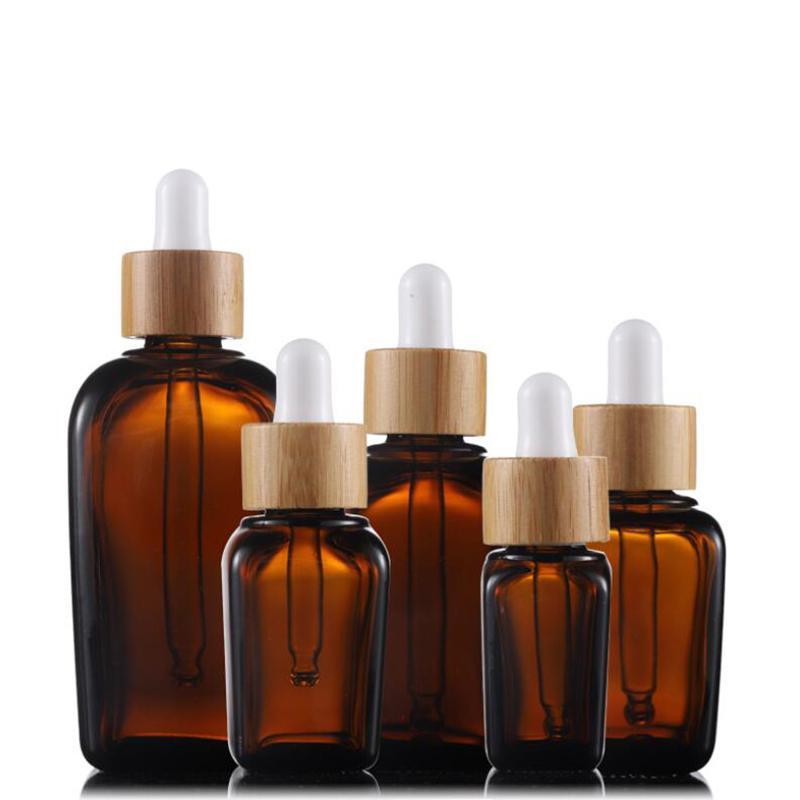 Los más populares 10ml 20ml 30ml 50ml 100ml Ámbar E perfume líquido Esenciales botellas de aceite de vidrio con gotero con el bambú casquillo para Cosméticos Esencia