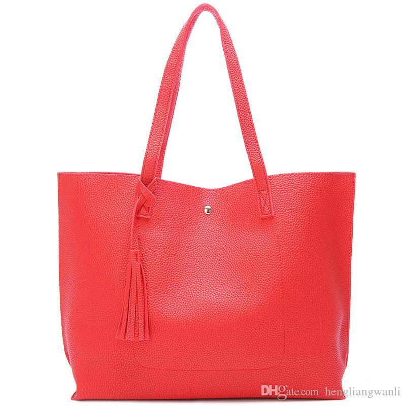 Nouvelle version coréenne du sac à bandoulière sac à main pompon couleur unie dames de grande capacité PU paquet portable diagonale