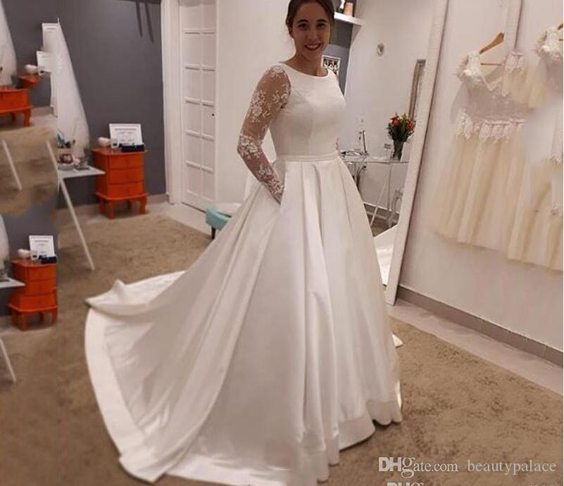 Discount Custom Long Sleeves Lace Appliques Wedding Dresses 2020 With Pockets Scoop Neck Court Train Satin Wedding Bridal Gowns Wedding Dresses For Older Brides Wedding Gown Designs From Beautypalace 126 6 Dhgate Com