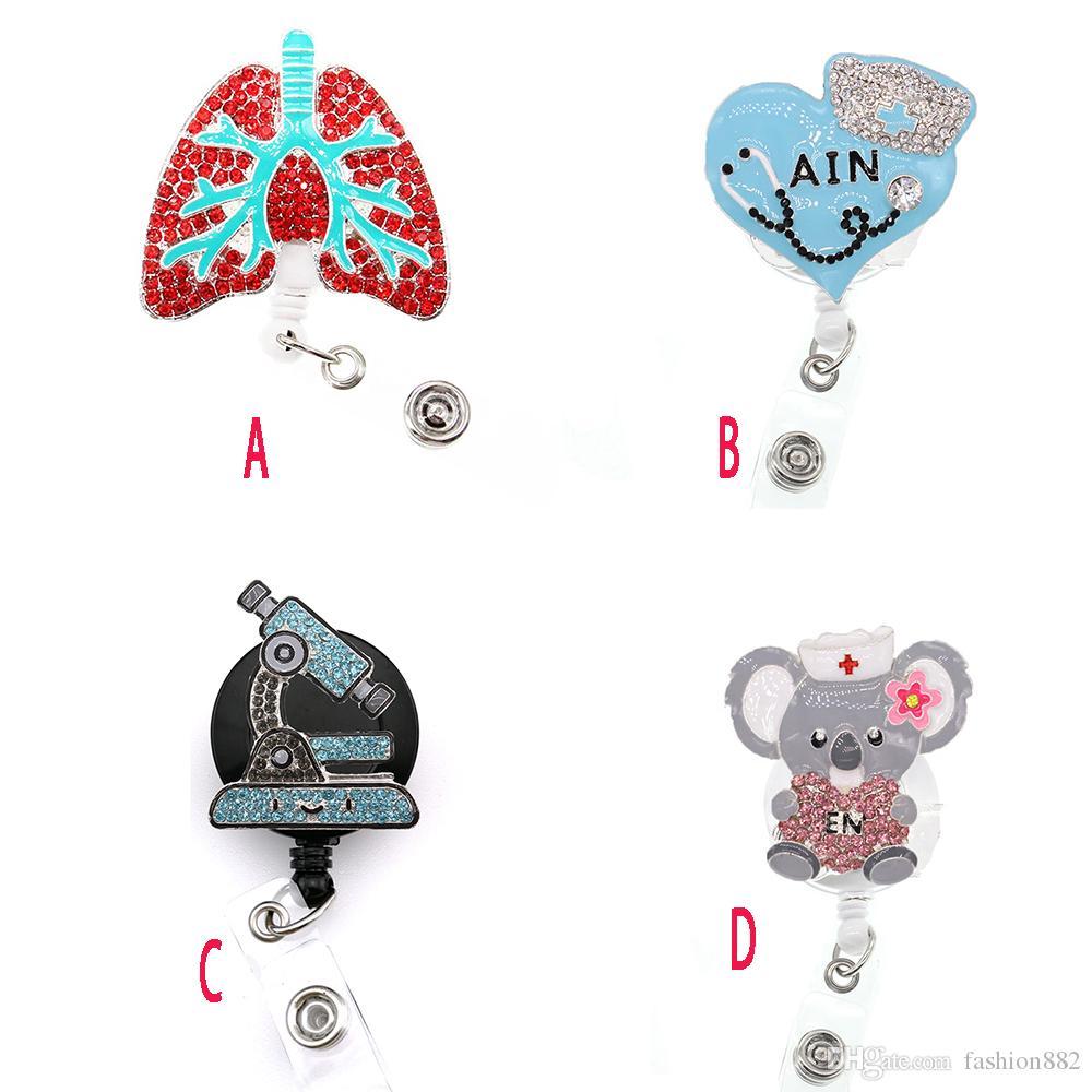 10 pz / lotto Nuovo Design Documental Nurse Retrattile strass cristallo smalto smalto medico rosa polmone Ain Bear ID Badge Badge Holder Holder clip