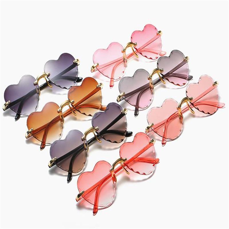 Fasion Kadınlar Zarif Güneş Gözlüğü Kırpma Çerçevesiz Güneş Gözlükleri Gözlük Anti-UV Gözlükler Kesim Kalp Gözlük Gözlük A ++