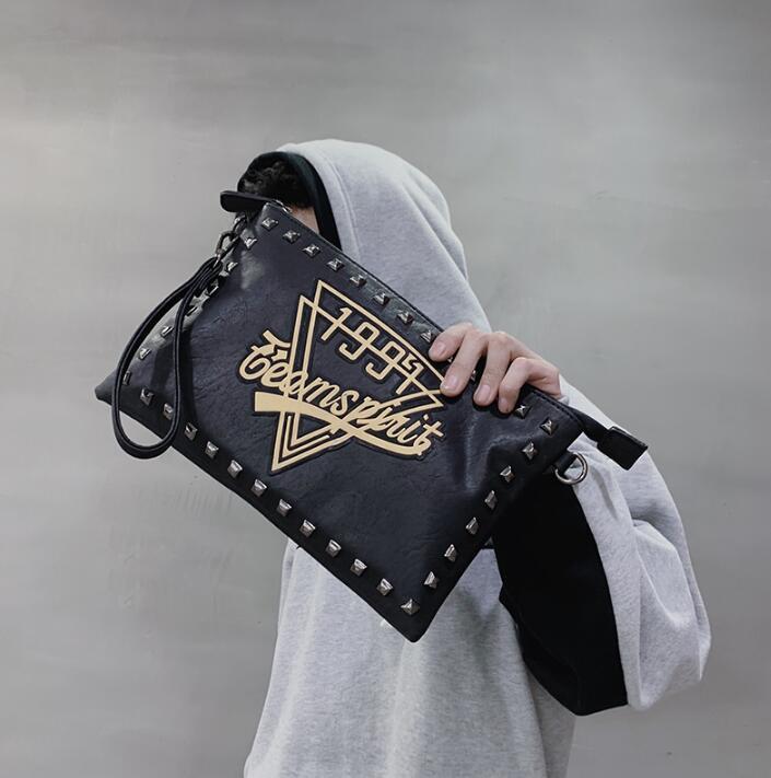 Wholesale brand men handbag personality pattern men and women handbags street trend rivets hand bags fashion printed leather shoulder Messen