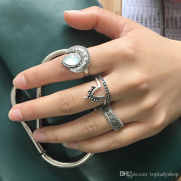 Europa y América del bohemio retro ópalo ajuste anillo de la cola luna tallada en forma de Porro gitano de cuatro piezas al por mayor anillo de envío libre