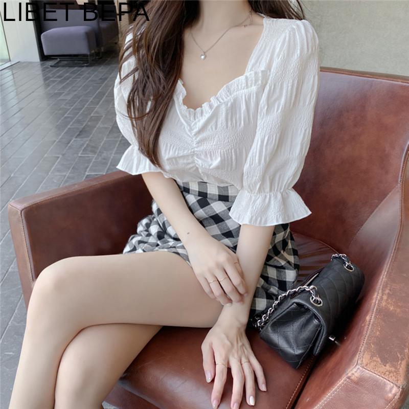 Camisa casual blusas nuevo 2020 verano de las mujeres de moda de la linterna de la manga del cordón salvaje del doblez de moda blanco elegante Tops BL3165