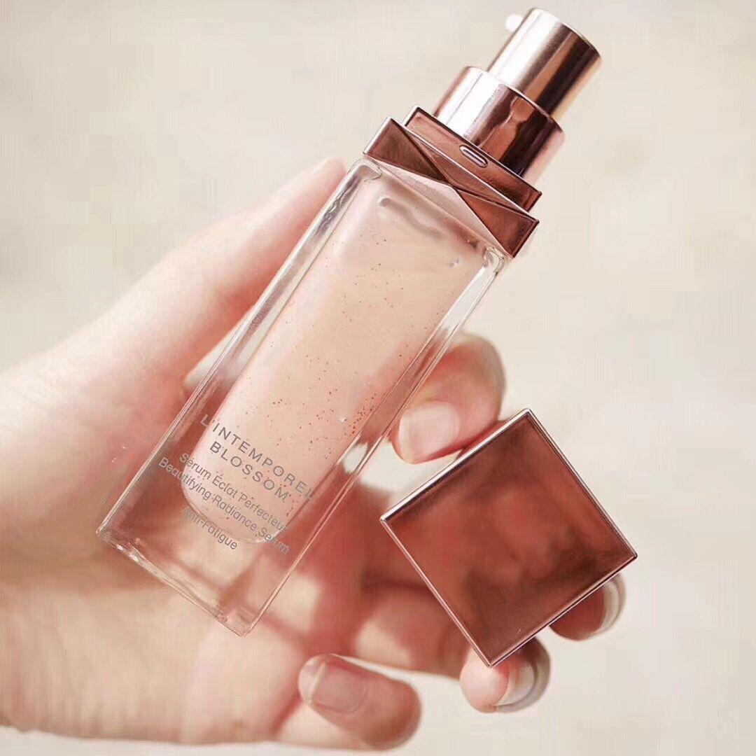 Ünlü marka çiçeği güzelleştirici parlaklık yüz serum 30ml / 1oz nemlendirici özü sıvı cilt bakımı yüz bakım losyonu.