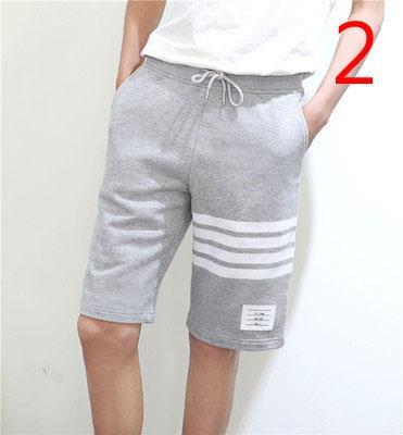 Мужские сплошной цвет случайные штаны Корейский пляж брюки тенденция пять летних