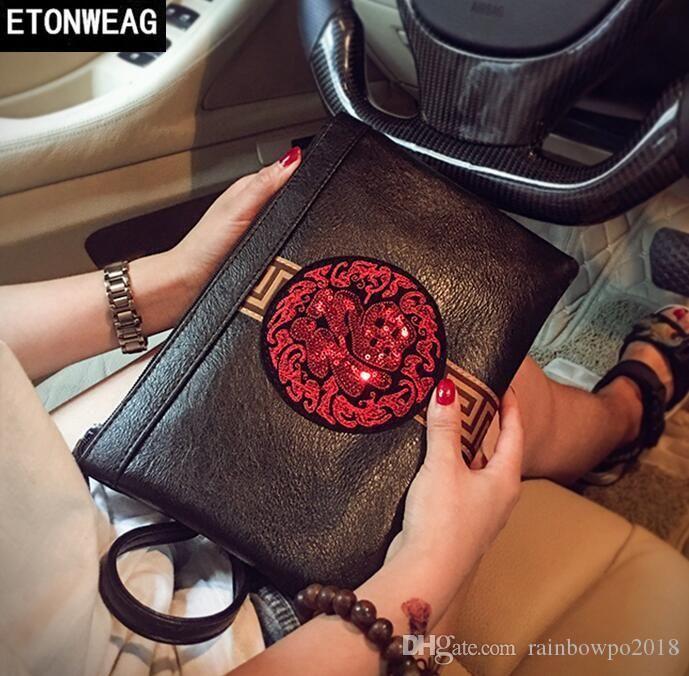 Original design Chinese style sequins hand grab personality leather Korean version handbag street fashion embroidery envelope wrist bag