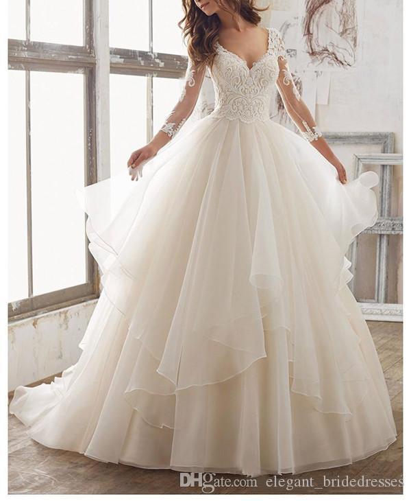 Impresionantes vestidos de novia con volantes de organza bordados 2020 Nuevo cuello en V de manga larga Ver aunque atrás Vestidos de novia Vestido de fiesta de boda en la playa Largo