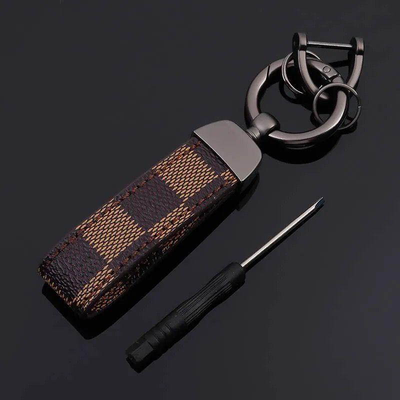Europa und Amerika-Art-Schlüsselanhänger mit Leder Business Car Schlüsselanhängern für Männer Geschenk Art und Weise klassischen Druck Tasten Accessorieshjuihhhhjh