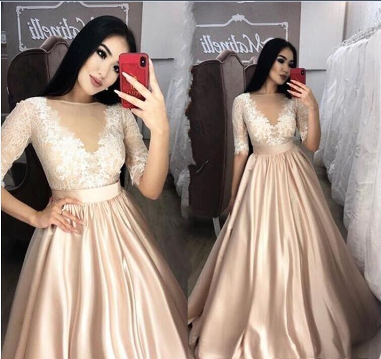 Nuevos vestidos de fiesta atractivos para champán 2019 Sheer Neck 1/2 manga apliques de encaje Una línea de longitud de piso Vestido de noche Fiesta Vestidos formales