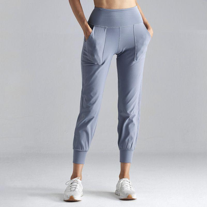 Moonglade yoga Aptidão bolsos das calças fêmeas solto Beams Lazer nenhum vestígio de cintura alta eleve os quadris Sports Abdominal Elasticidade