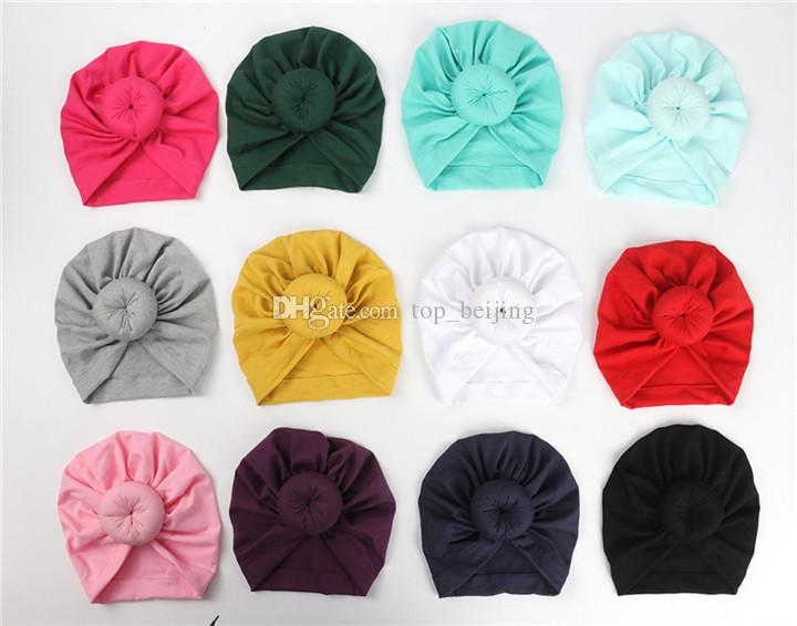 2020 Hot Fashion Cute Infant Baby Kids Toddler Children Unisex Ball Knot Colorful Baby Donut Hat Solid Color Cotton Hairban 12color