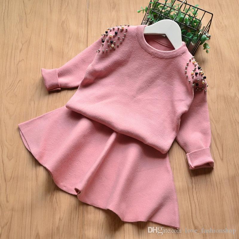 Einzelhandel Mädchen Boutique Outfits 2pcs Rock Sets koreanische Langarm Perle Perlen Strickpullover Pullover + kurzen Rock Kinder Outfits Kleidung Sets