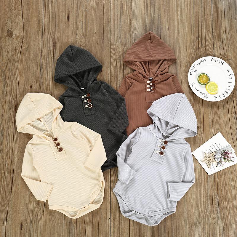 Nuevos y elegantes INS para bebés, niños, niñas, mamelucos, sudaderas con capucha, botones frontales de punto de algodón en blanco, correas de manga larga para bebés, monos con capucha, 0-2 t