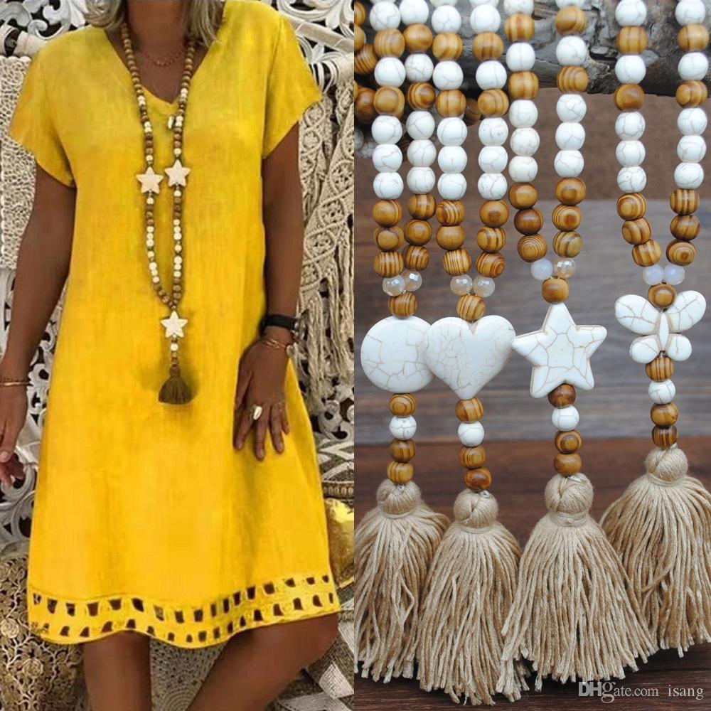 إمرأة Boheimian أزياء سلسلة طويلة الخرز الخشب قلادة الشرابة القلب فراشة ستار الصليب حجر الفيروز الخرزة مجوهرات
